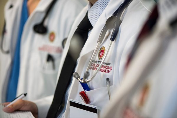 a medical student's white coat during floor rounds
