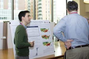 Poster Presenter explaining his poster to an attendee