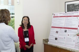Poster presenter describing her poster to an attendee