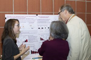 Poster Winner describing her poster to two participants