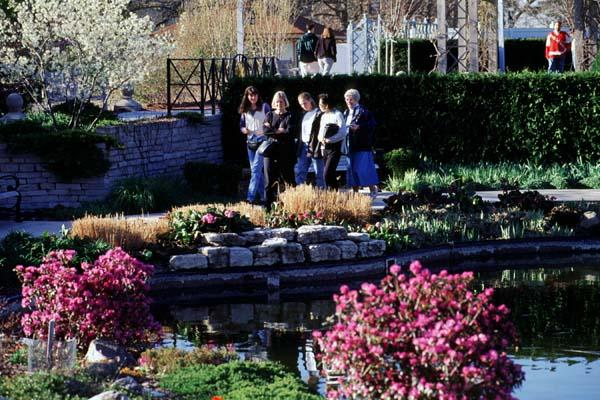 A group of five visitors walking through the Allen Centennial Gardens