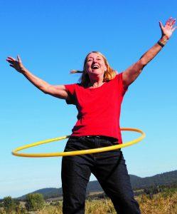 Woman hula hooping outside