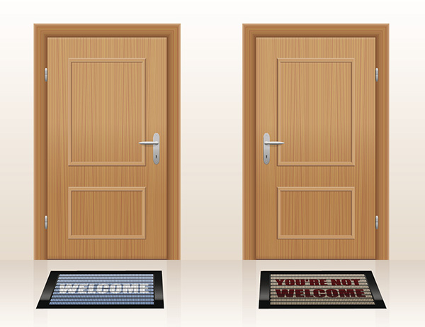 Two doormats saying WELCOME and YOU'RE NOT WELCOME.